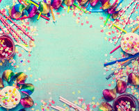 Happy birthday frame. Party tools with cake, drinks and confetti on turquoise shabby chic background, top view, place for text. Stock Image