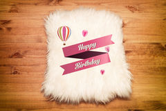 Happy birthday. fur carpet on wood floor Royalty Free Stock Photography