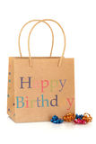 Happy Birthday Gift Bag. Made of recycled paper, with coloured curly ribbons, isolated over white background Stock Photos