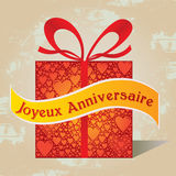 Happy Birthday Gift Box French Text with Heart Pattern and Ribbon in Red Colors Royalty Free Stock Photo
