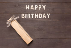Happy Birthday and gift box on wooden background with copy space Stock Image