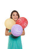 Happy birthday girl. Girl with happy birthday balloons in three colors Royalty Free Stock Photography