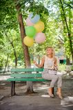 Happy birthday girl with a bouquet of pretty flowers and balloons Stock Photo