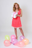 Happy birthday girl with gift and balloons Stock Photography