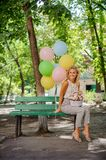 Happy birthday girl with pretty flowers and balloons Royalty Free Stock Images