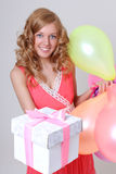 Happy birthday girl showing her gift. Happy birthday girl with balloons showing her gift Stock Images