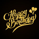 Happy Birthday - gold glitter hand lettering on Stock Photography