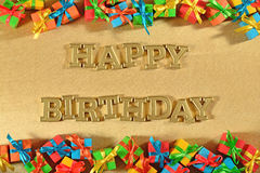 Happy birthday golden text and colorful gifts stock image