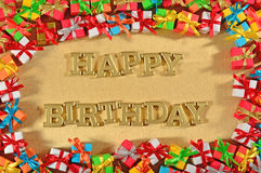 Happy birthday golden text and colorful gifts royalty free stock photos