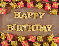 Happy birthday golden text and golden and red gifts Royalty Free Stock Photo