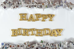Happy birthday golden text and silver gifts on a white royalty free stock image