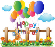 A happy birthday greeting with balloons Stock Images