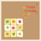 Happy Birthday. Greeting birth card in the autumn months. Postcard multi coloured autumn leaves. Happy Birthday vector illustration. Greeting birth card in the stock illustration