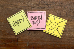 Happy Birthday greeting card or banner. Handwriting on sticky notes on rustic wood Royalty Free Stock Image