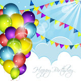 Happy Birthday greeting card with colorful balloons, confetti and flags. Stock Photo