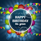 Happy Birthday greeting card with colorful balloons and flags on a blue background. Stock Photos