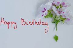 Happy birthday greeting card with fresh flowers on white background. Space for text stock image