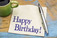 Happy Birthday greetings on napkin with coffee Stock Images