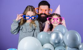 Happy birthday. Having a family celebration. Happy family celebrating birthday party. Family party. Family of father and. Daughters wearing party goggles royalty free stock images