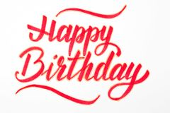Happy Birthday lettering on white background. Happy Birthday lettering on white background Royalty Free Stock Photography