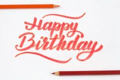 Happy birthday lettering on white background with pencils. Happy birthday lettering on white background with pencils Stock Image