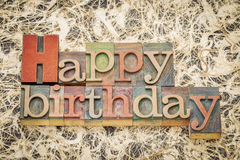 Happy Birthday in letterpess wood type. Happy Birthday greeting card - word abstract in letterpress wood type against amate paper Stock Photo