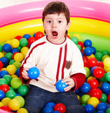 Happy birthday of little boy in balls. Royalty Free Stock Photo