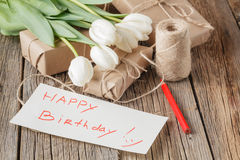 Happy birthday mesage with flowers on rustic table with flowers Royalty Free Stock Photo