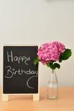 Happy birthday message and hydrangeas Stock Image
