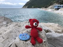 Happy Birthday message on a stone with a red wool bear royalty free stock photo