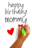 Happy birthday mommy. Girls hand holding a pen writing happy birthday mommy greeting card Stock Image