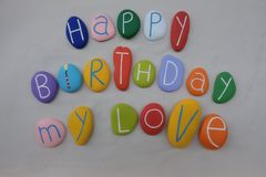 Happy Birthday My Love with colored stones over white sand