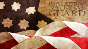 Happy Birthday National Guard. Usa Flag Waves. And Wood Stock Photo