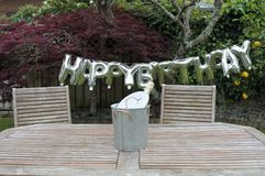 Happy birthday party sign in a home garden Royalty Free Stock Photos