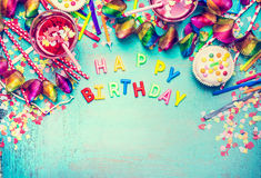 Happy birthday , party tools and decoration , drinks on turquoise shabby chic background, top view place for text, border Royalty Free Stock Image