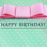 Happy Birthday. pink bow, turquoise background, polka dots. greeting card stock image