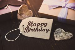 Happy Birthday present gift hipster vintage man. Table stock photo