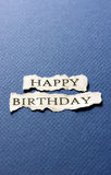 Happy birthday on scrap of paper Stock Photography