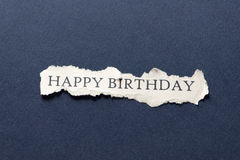 Happy birthday on scrap of paper Royalty Free Stock Photos