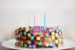 Happy Birthday sign and candles on child candy cake Stock Image