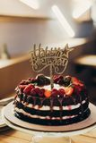 Happy Birthday sign on chocolate cake Royalty Free Stock Images