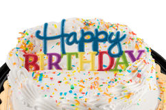 Happy birthday sign on white iced cake Royalty Free Stock Photography