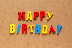 Happy Birthday text on cardboard background Stock Images