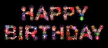 Happy birthday text colorful fireworks. Isolated on black background Royalty Free Stock Photography