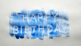 Happy birthday text inscription watercolor artist paints blot isolated on white background art. Happy birthday text inscription watercolor artist paints blot stock video footage