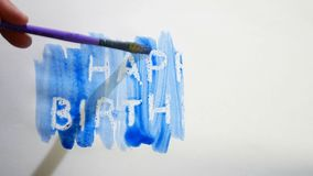 Happy birthday text inscription watercolor artist paints blot isolated on white background art video. Happy birthday text inscription watercolor artist paints stock video