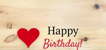 Happy Birthday Text and Red Heart. On a Wooden Background stock photo