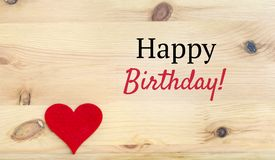 Happy Birthday Text and Red Heart. On a Wooden Background stock images