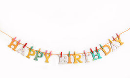 Happy birthday text with wooden letters on a white background. Royalty Free Stock Photo