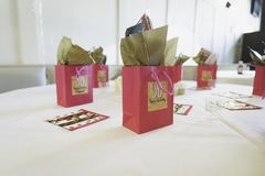 Happy Birthday to a 30th. Party Favors and small gift bags are set over a white table with high key lighting royalty free stock image